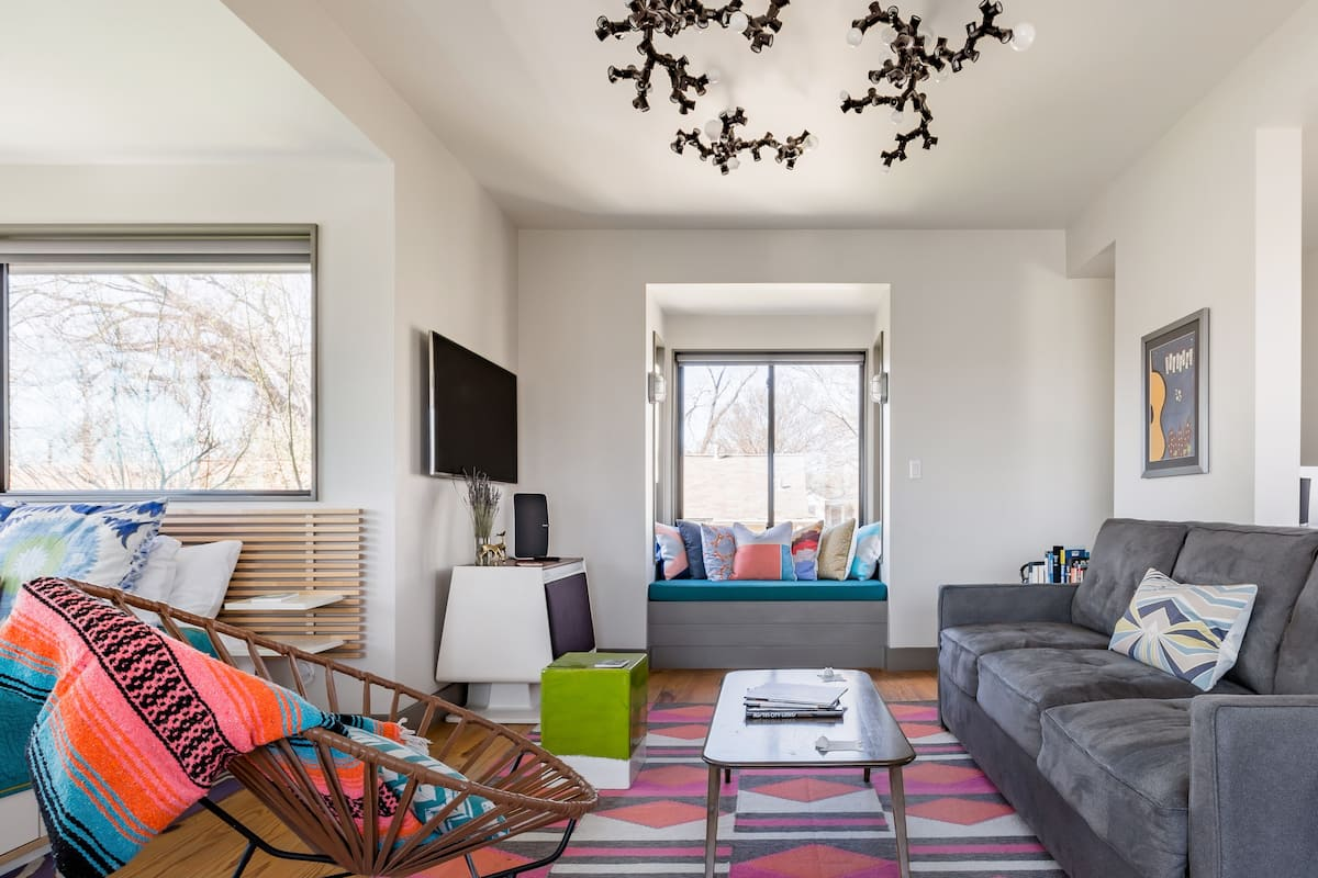 Curl up in the Window Seat at a Colorful Modern Treehouse