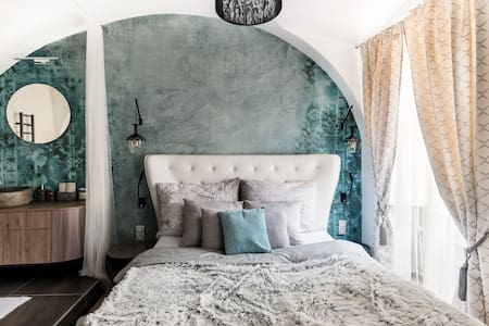 Wander Across Charles Bridge at a Grand, Romantic Apartment