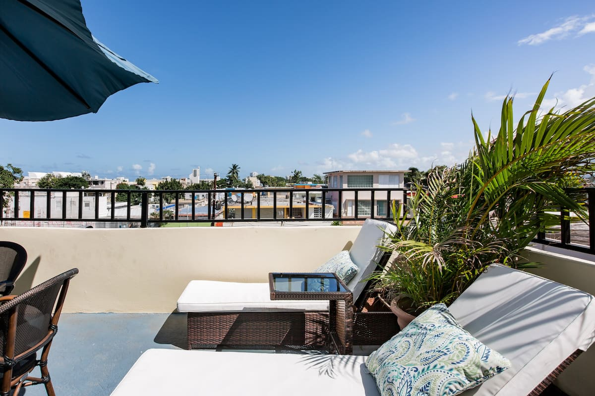 Soak up the Sun on the Tropical Rooftop Deck in Santurce