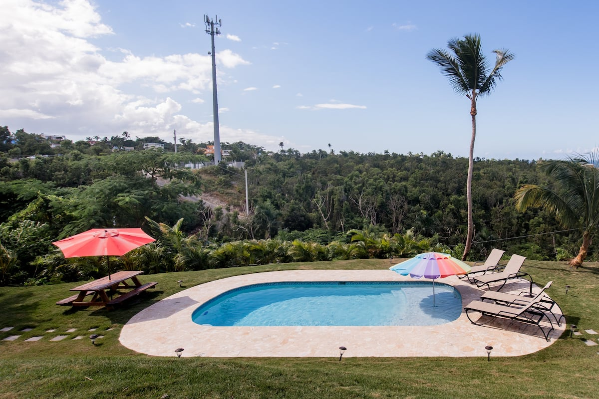Walk to Sandy Beach from a Hilltop Villa with a Pool