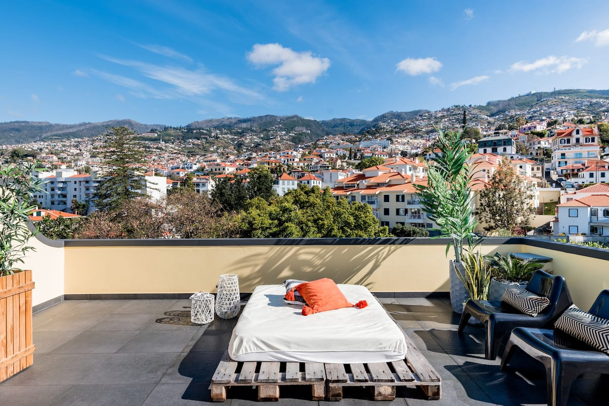 Admire the Hillside's Red Rooftops from the Terrace Day Bed