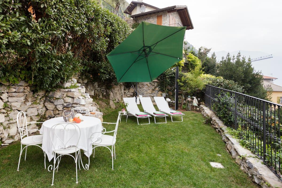 Relax e delizie in prezioso appartamento con giardino e vista sul lago