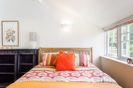 Retreat to a Sunlit Two-Level Bedroom after Sightseeing