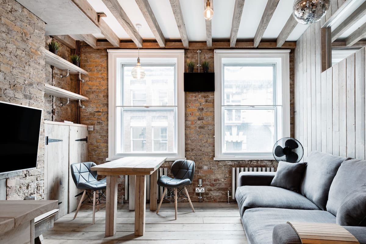Soho Unique Wood and Brick Suite in the Heart of Soho