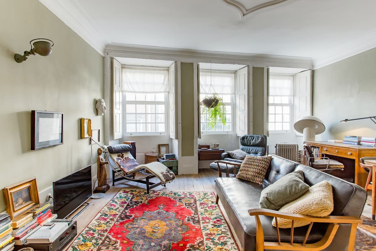 Walk to Museums from a Vibrant Apartment Filled with Books