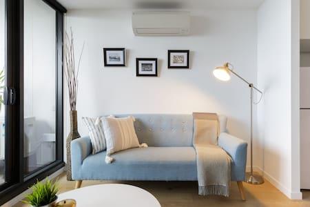 Wake Up to Sweeping City Views at Beautiful Modern Home