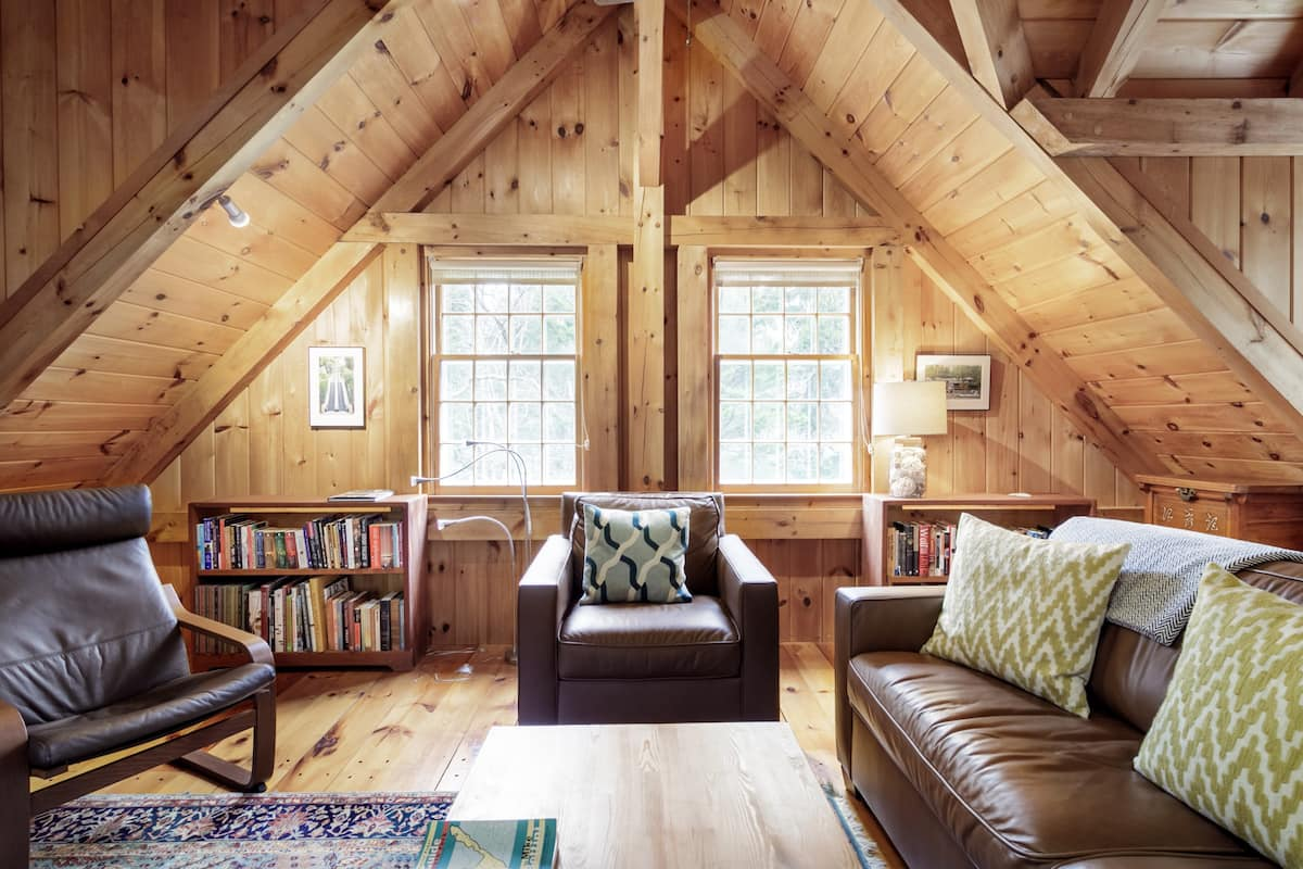 Get Cozy Under the Rustic Beams at a Woodland Hideaway