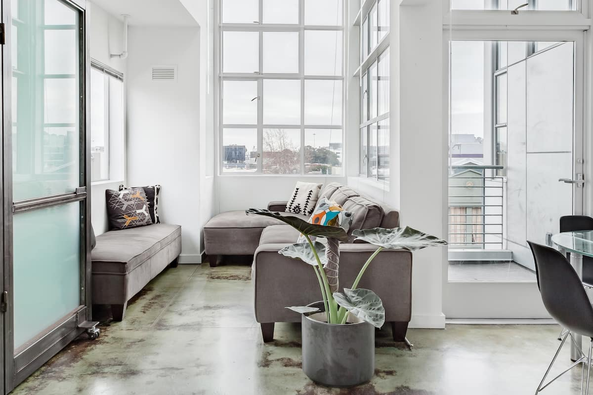 Industrial-Chic Loft with Private Roof Deck and City Views