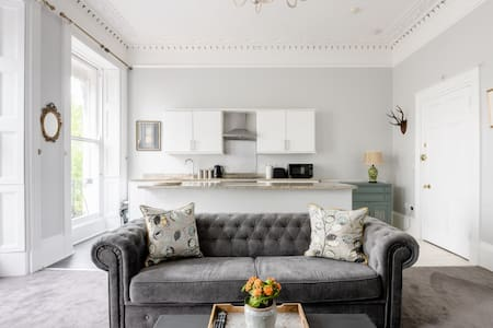 Decompress on the Chesterfield at a Refined Regency Abode