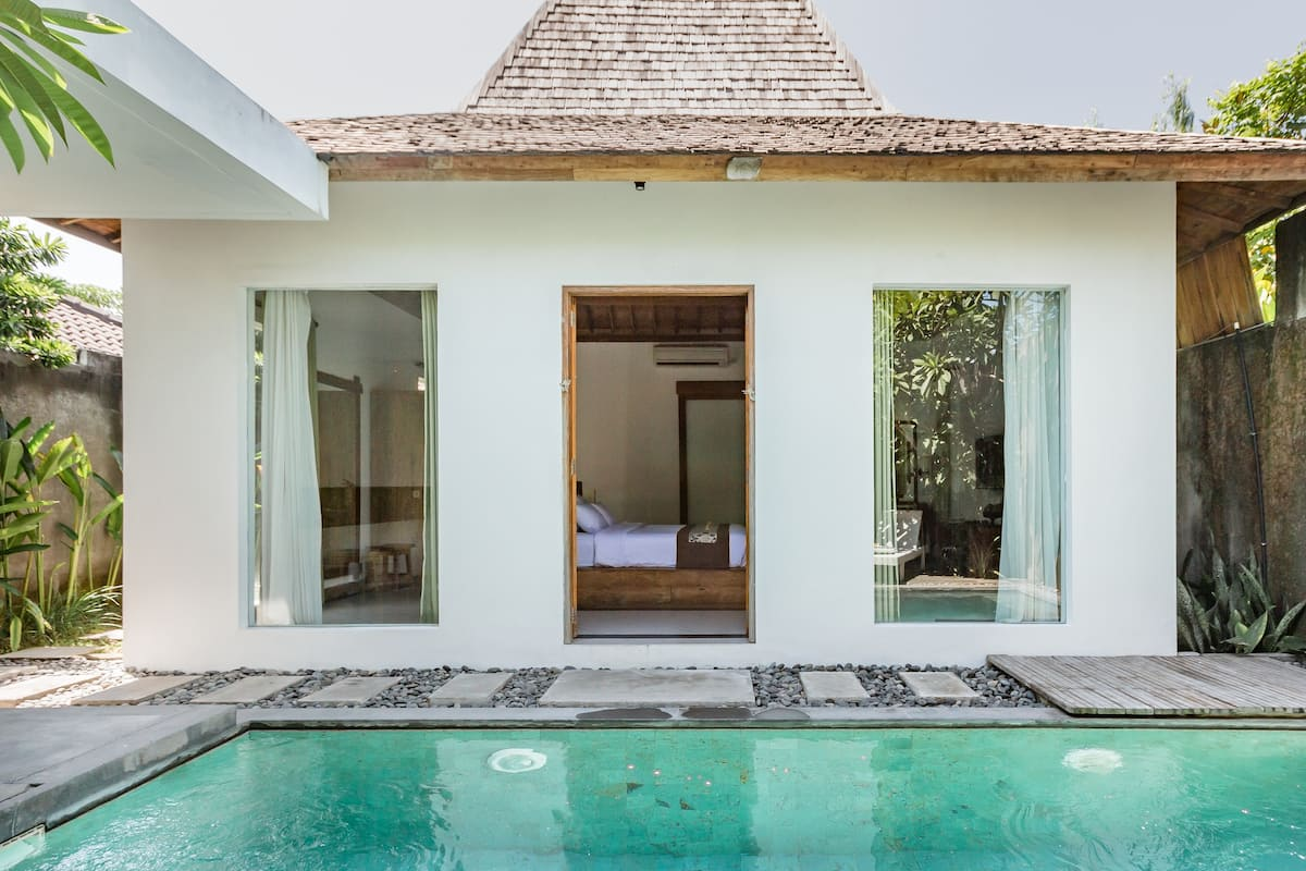 Lounge Poolside under Abundant Fruit Trees at an Airy Oasis