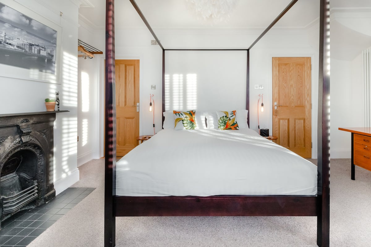 Boutique Bedroom with Private Roll Top Bath