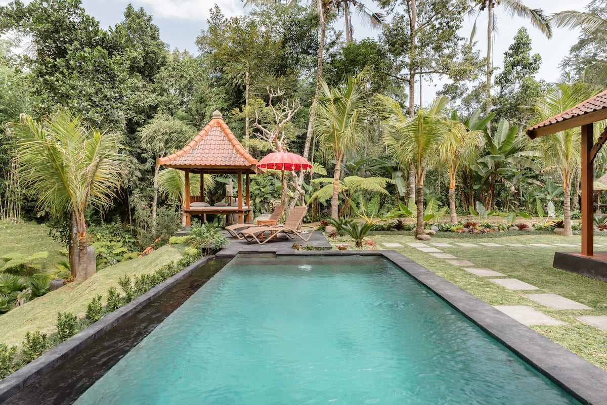 Private Oasis with Pool amid Tropical Trees and Rice Fields