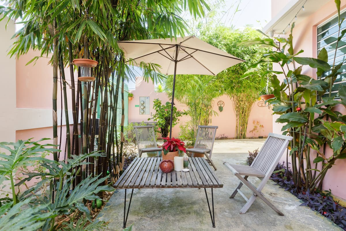 Recharge on the Leafy Patio of this Serene Apartment