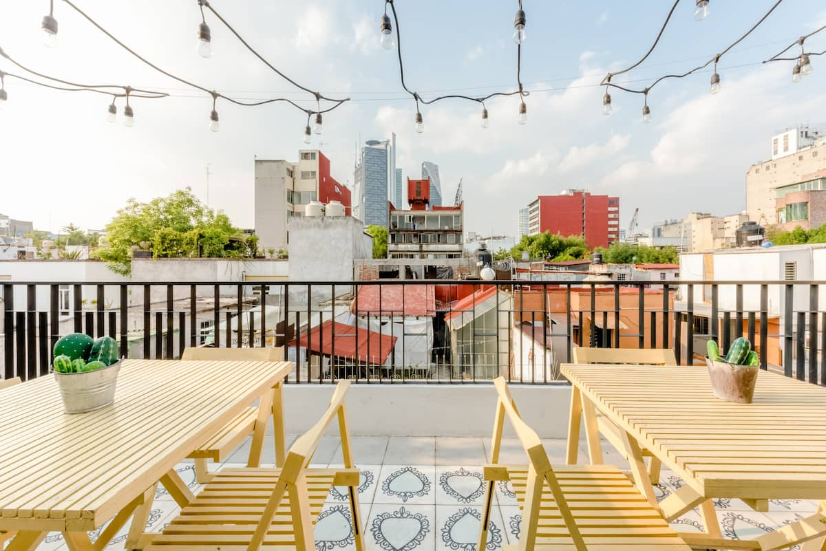 Admire Mexico City from a Twinkling Balcony by La Palomilla