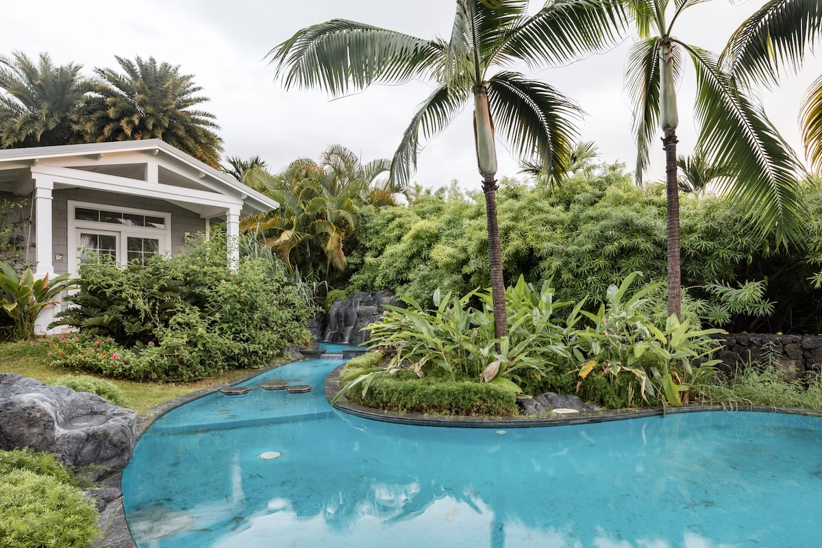Pristine Gated Villa with a Palm-Shaded Pool near the Beach