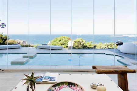 Captivating 180-Degree Sea Views from a Hillside Villa