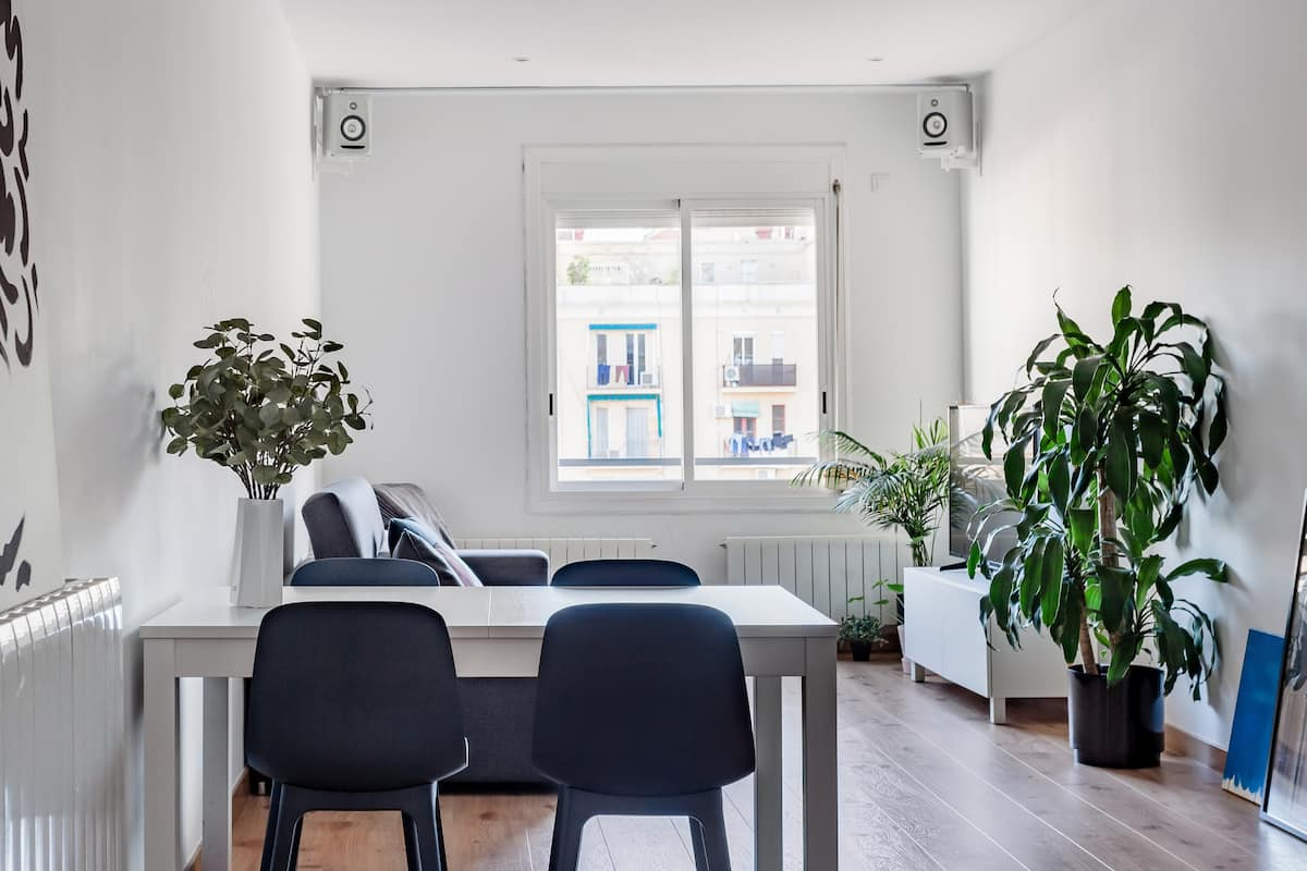 Leafy, Light-Filled Eixample Home with Minimalist Style