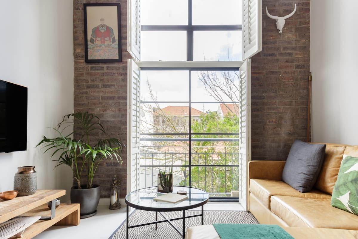 Explore the City's Trendiest Street at a Super Stylish Pad