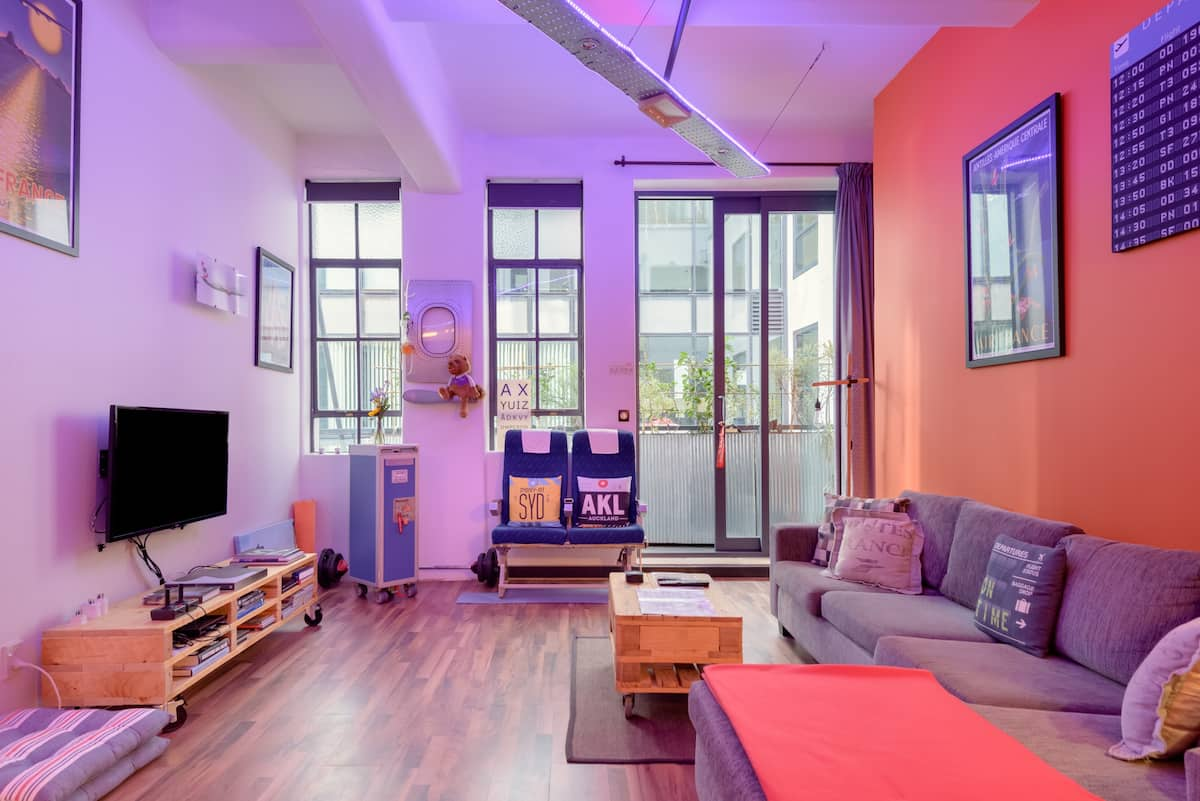 Special Offer Eclectic, Colourful Airplane-Themed Loft