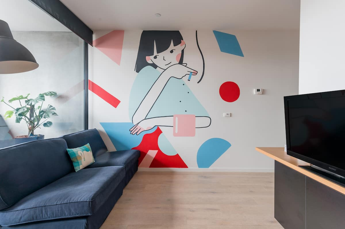 Admire the Unique Mural at a Colourful Rooftop Residence