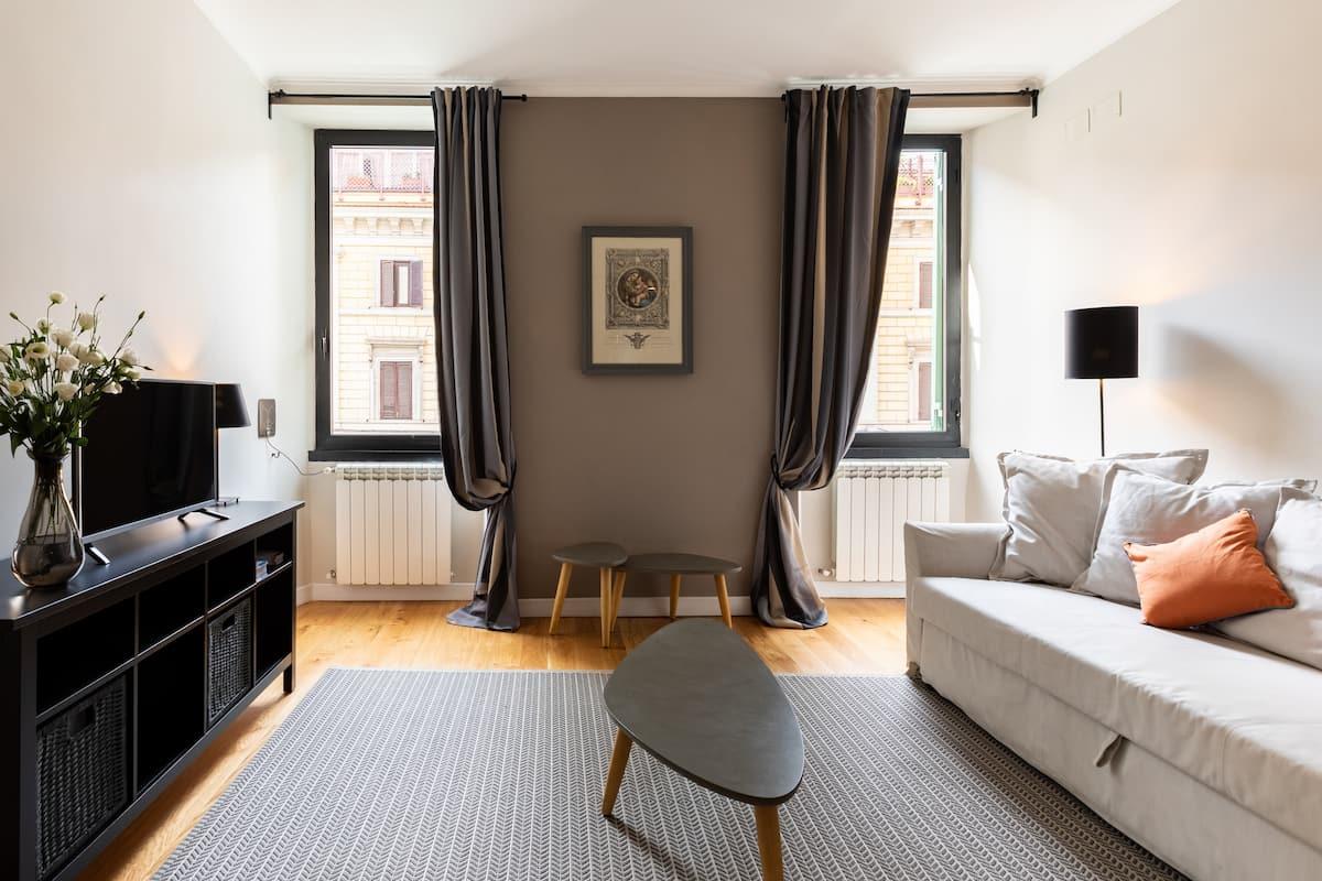 Raffinato Appartamento con Patio nel Quartiere Monti