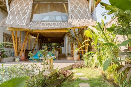 Bamboo Guesthouse with Open Living, Tropical Garden & Pool
