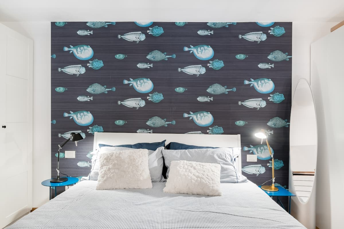 Unwind in the Sea-Themed Mezzanine Bedroom at a Luxe Loft