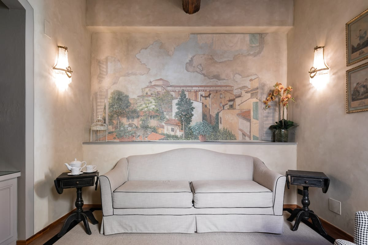 Admire a Rustic Florentine Mural in the Cozy Reading Nook