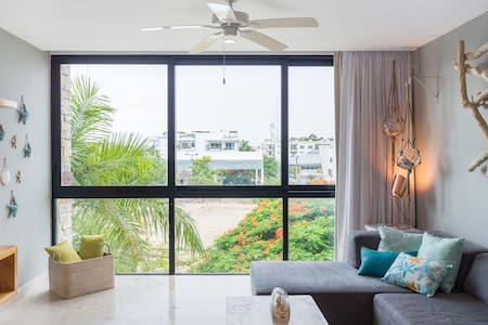 Walk Everywhere from a Fully Equipped, Beachy Condo