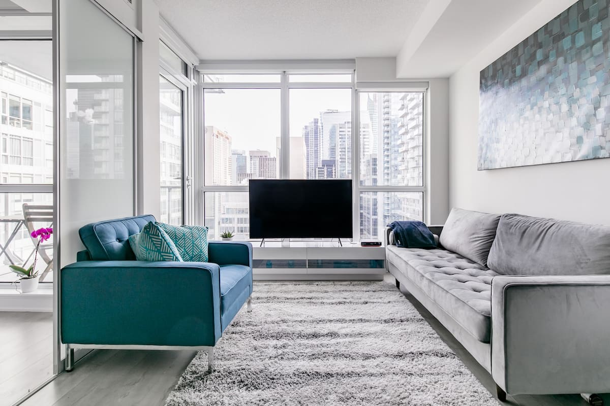 Sink into the Velvet Sofa at a Luxe Pad with High-Rise Views
