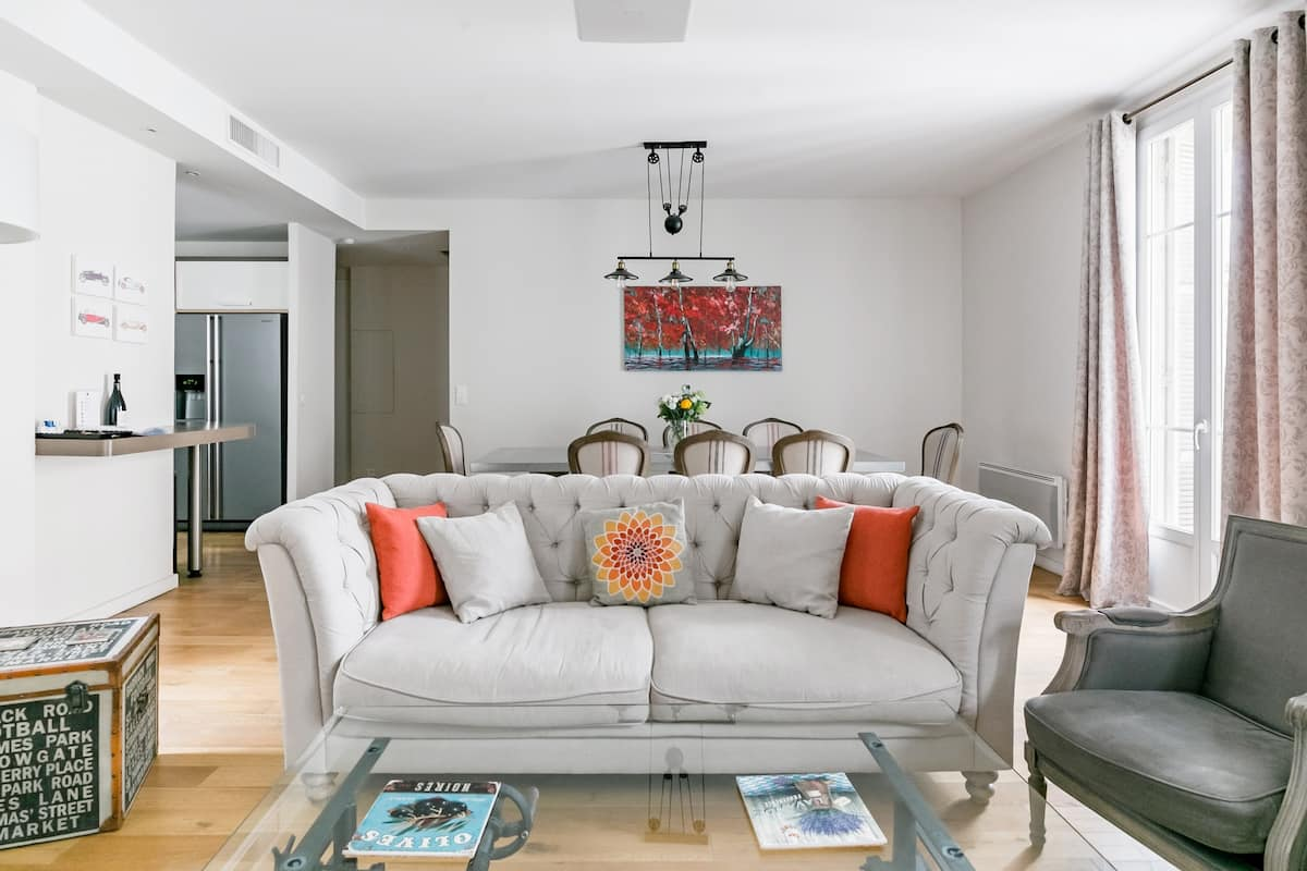 Stroll to Big-Name Boutiques from Caravel Apartment