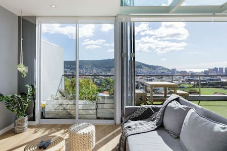 Modern, Chic Penthouse with Mountain, City & Sea Views