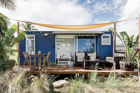 Experience Tropical Camping at a Cabin Close to the Ocean