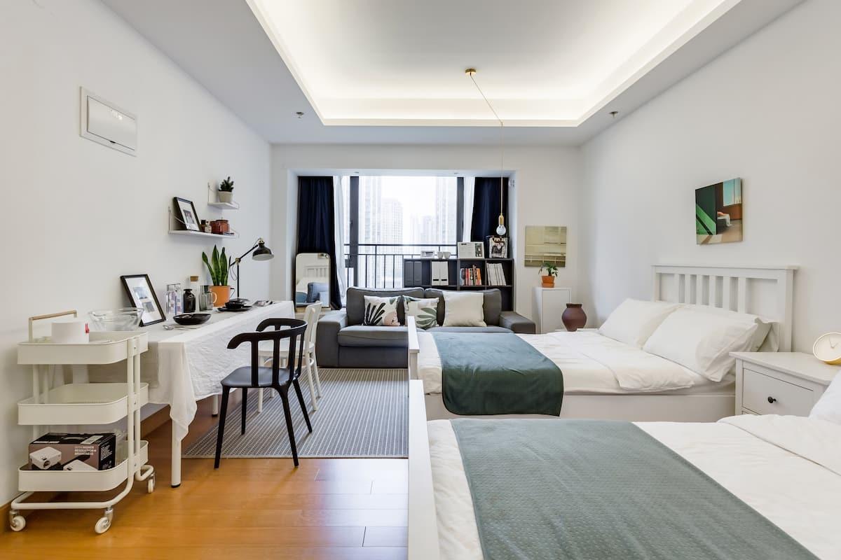 下榻洁白的高级公寓去狂逛万象城