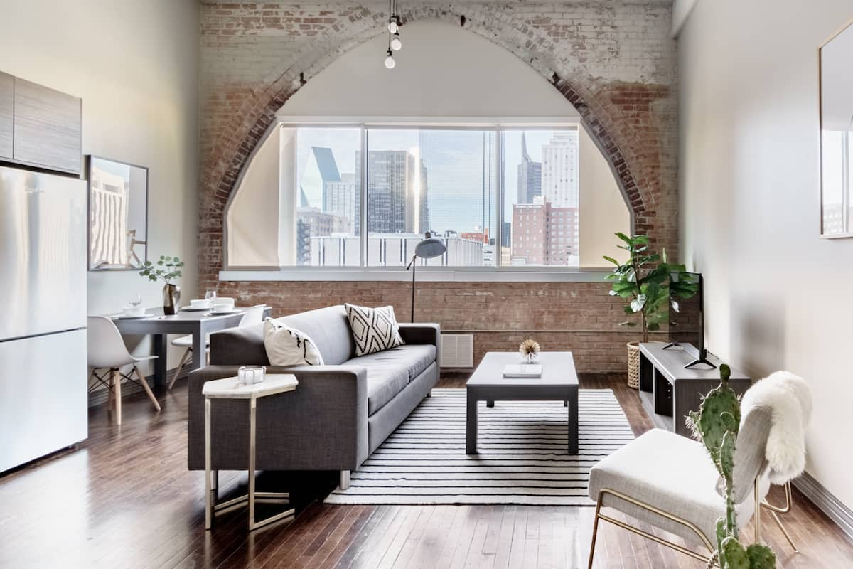 See Skyscrapers from the Window of a Trendy Loft