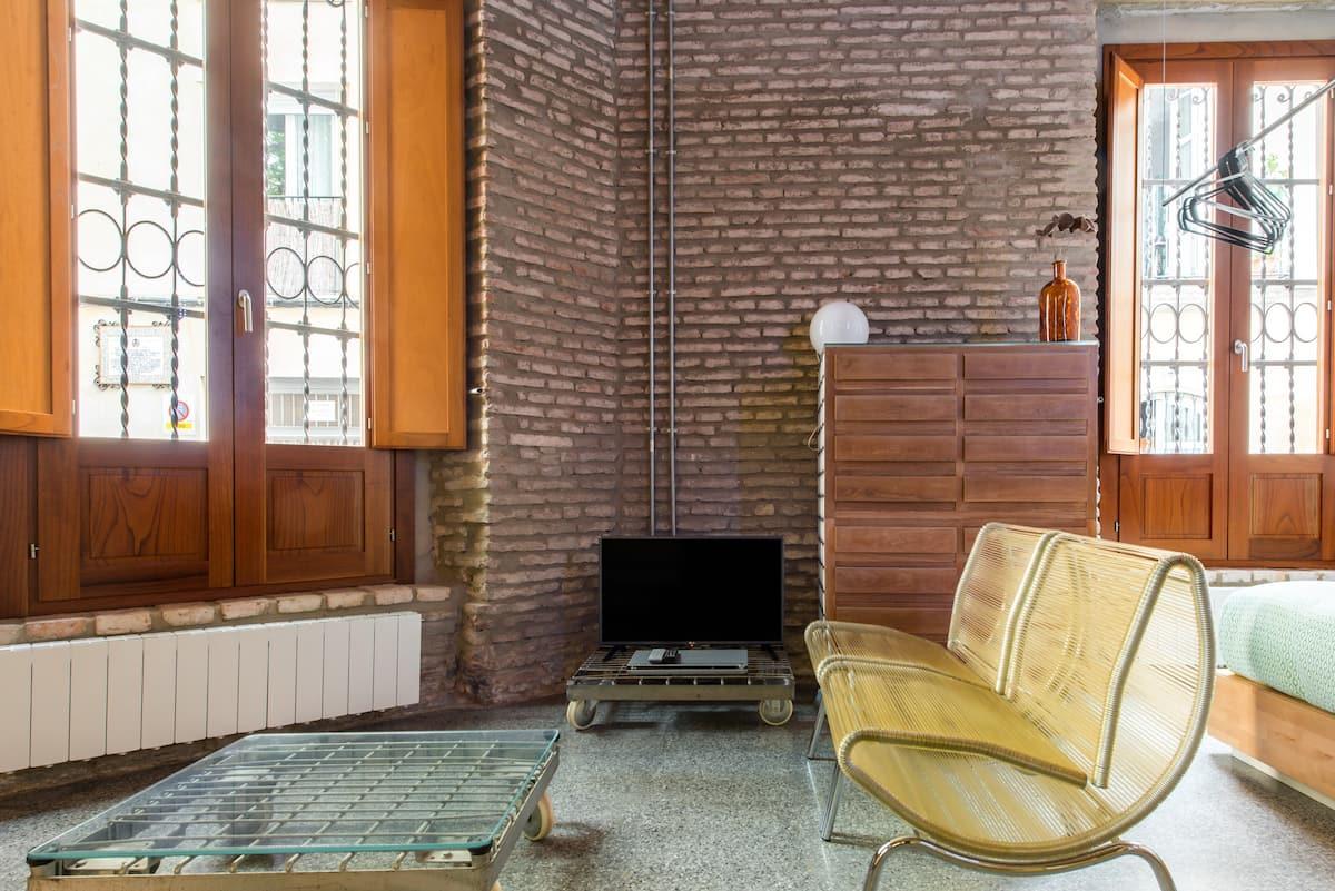 Designer, Industrial-Style Studio Apartment
