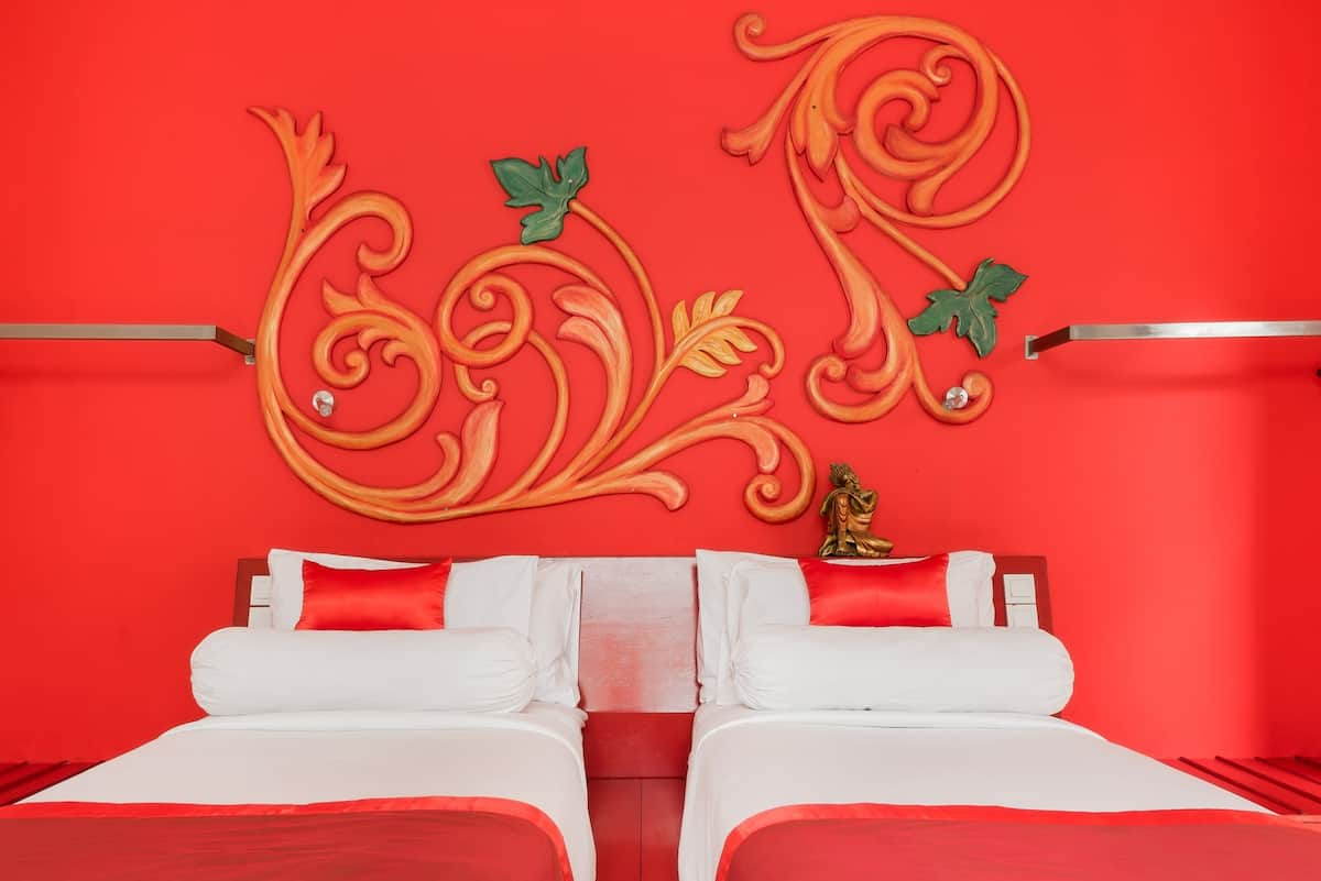 Soak up the Vibrant, Red Interior at a Poolside Garden Suite