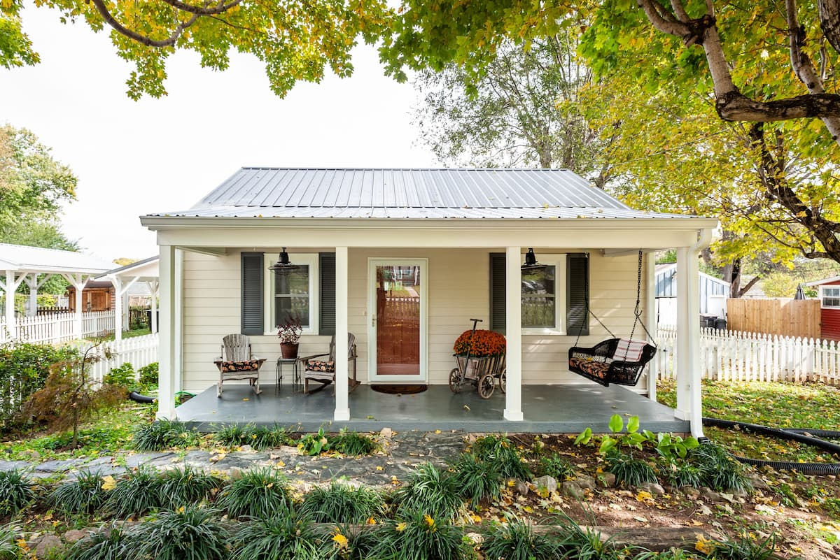 Tiny Renovated Cottage with Rocking Chairs on the Porch