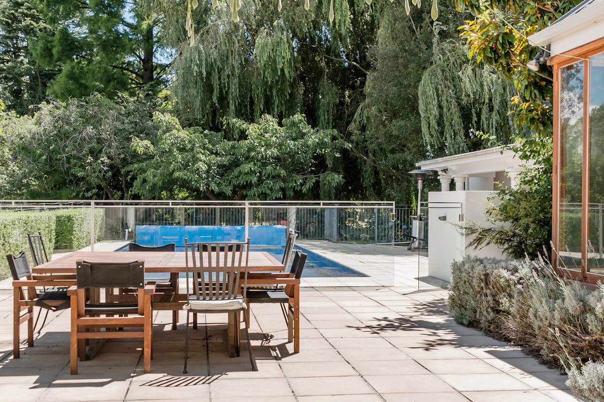 Soak up the Sun on the Tennis Court at a Creekside Haven