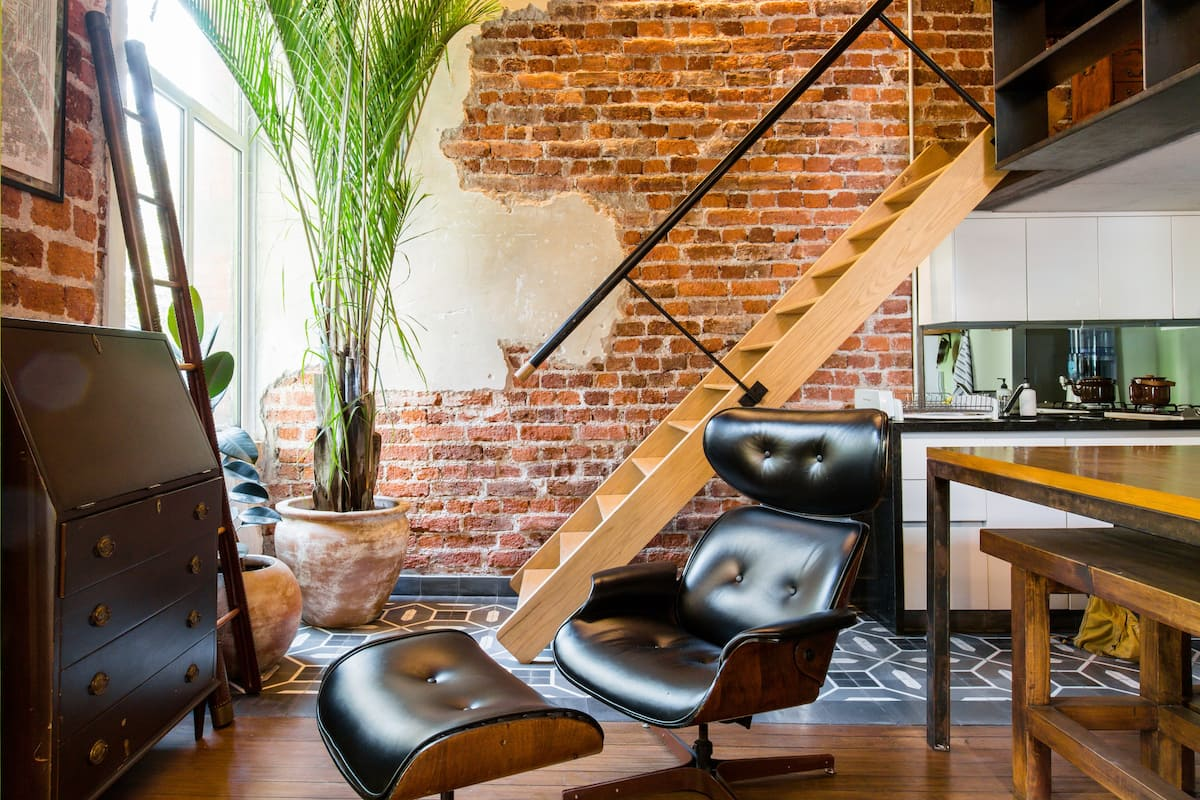 Bricks, Leather, and Rustic Wood at a 1920s Character Loft