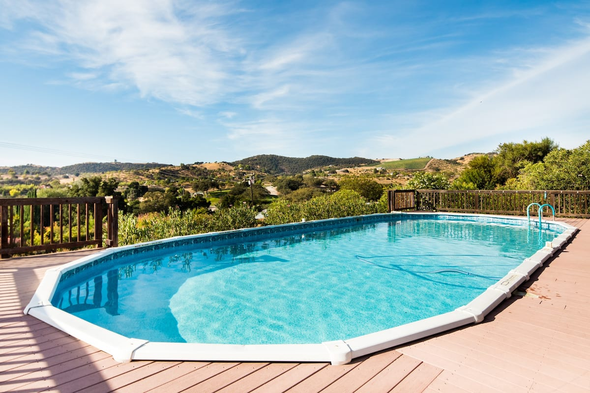 Take in Panoramic Poolside Views in Spanish-Style Home