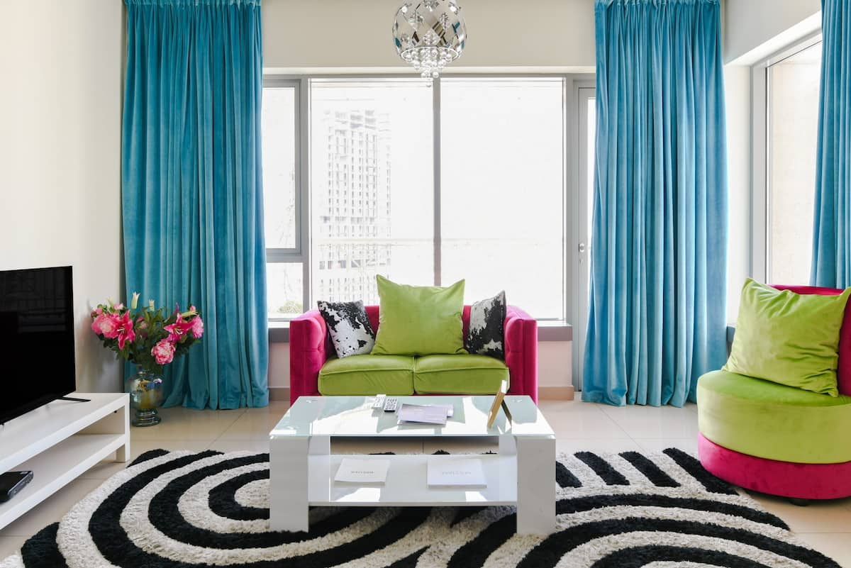 Sink into a Multicolored Lounge Chair at a Vibrant High-rise