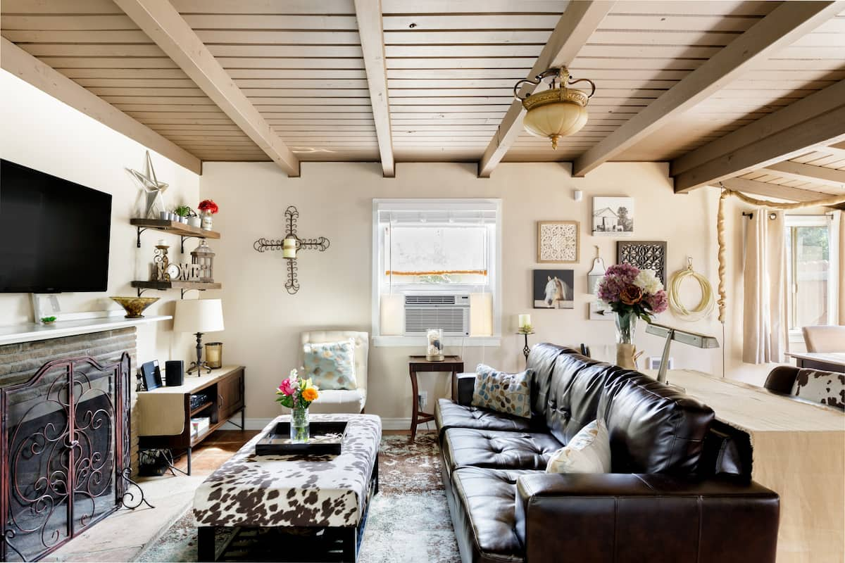 Snuggle up on the Leather Sofa at a Stable-turned-cottage