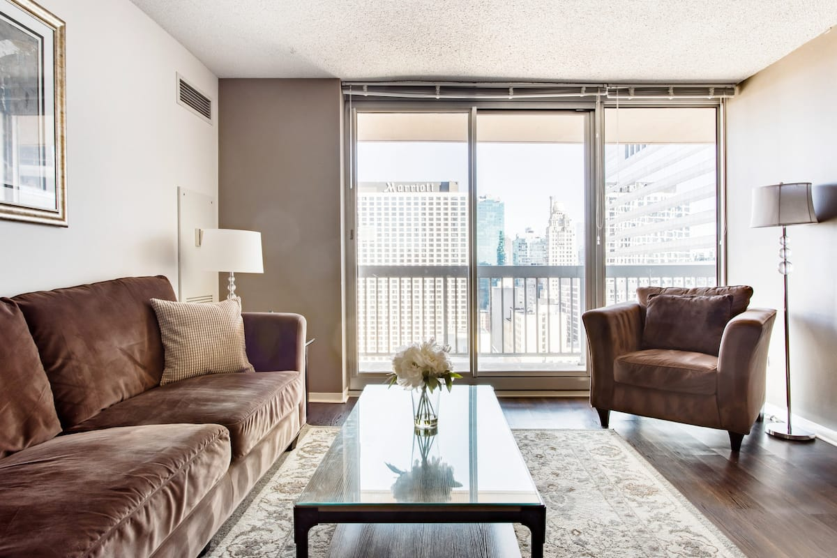 Walk Downtown from a Dog-Friendly Condo with a Pool and Gym