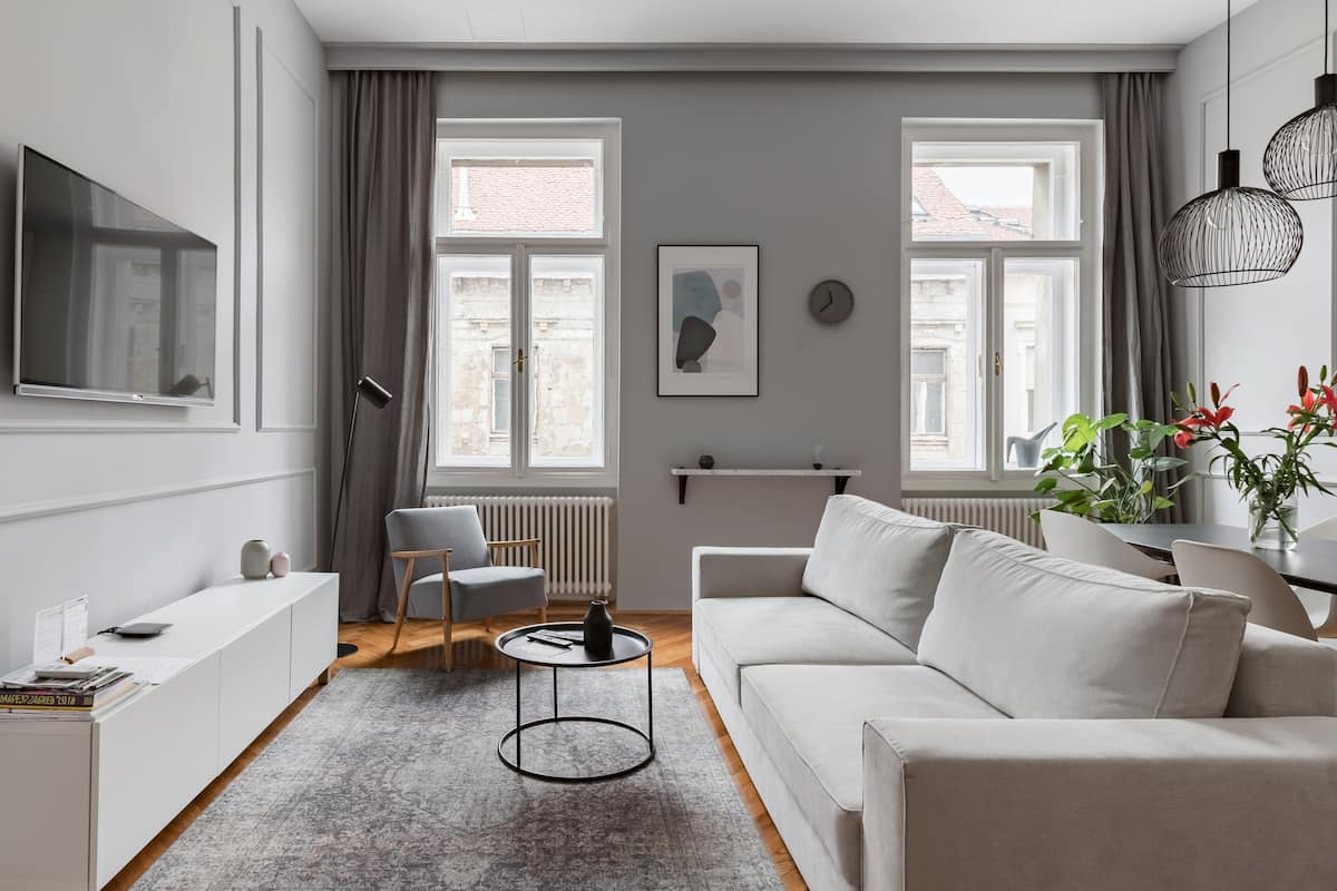 Find Calm at a Chic Grayscale Residence with Wood Accents