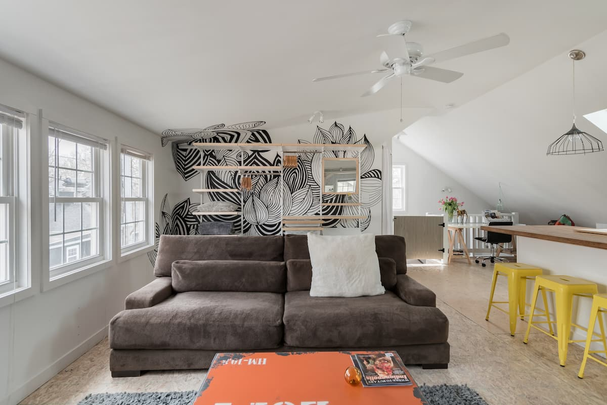 Sink into the Slouchy Suede Couch at a Industrial Eco Loft