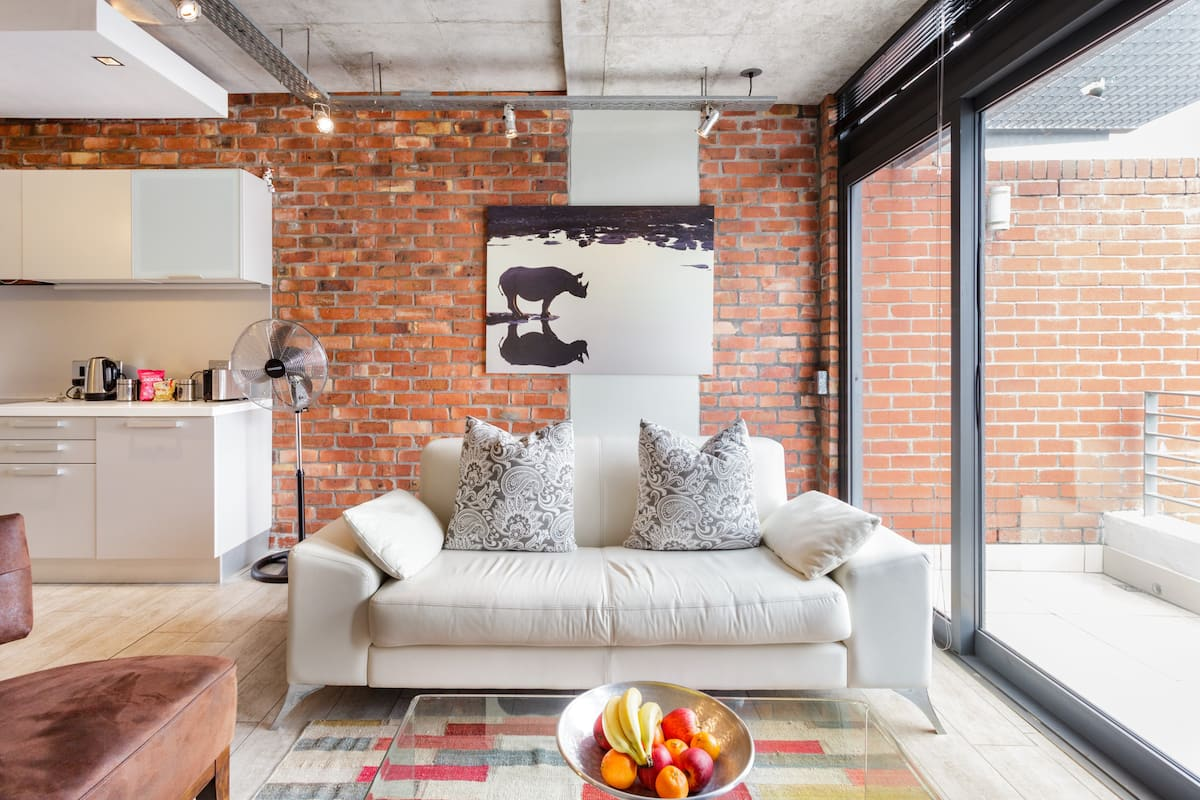 View Table Mountain from a Stylish Industrial Loft