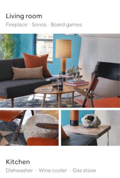 현대적인 가구가 놓인 채광이 좋은 거실. 마호가니 재질 의자의 정교한 팔걸이 장식과 정동석이 놓인 나무 협탁이 보입니다.