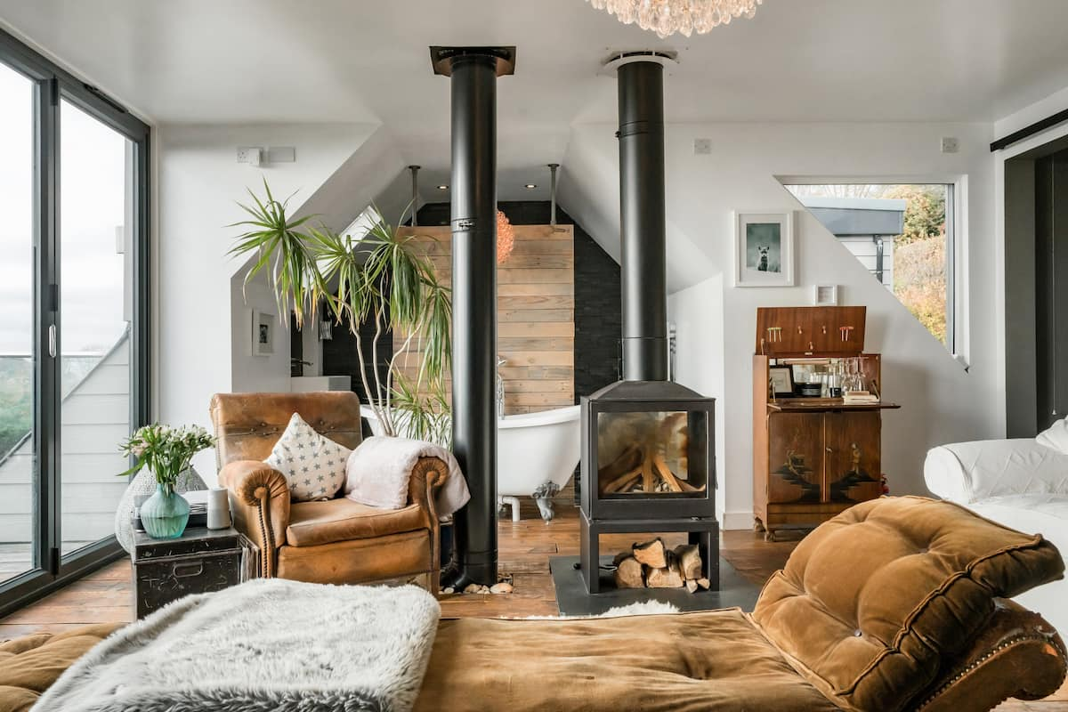 Lounge on a Toffee Velvet Chaise at a Cosy Coastal Loft
