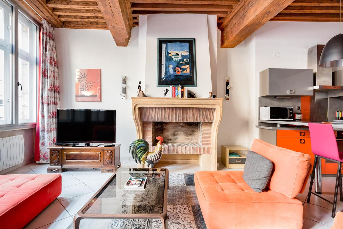 Curl up by the Intricate Brick Fireplace at an Old Lyon Home